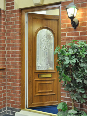 Oak effect pvc entrance door